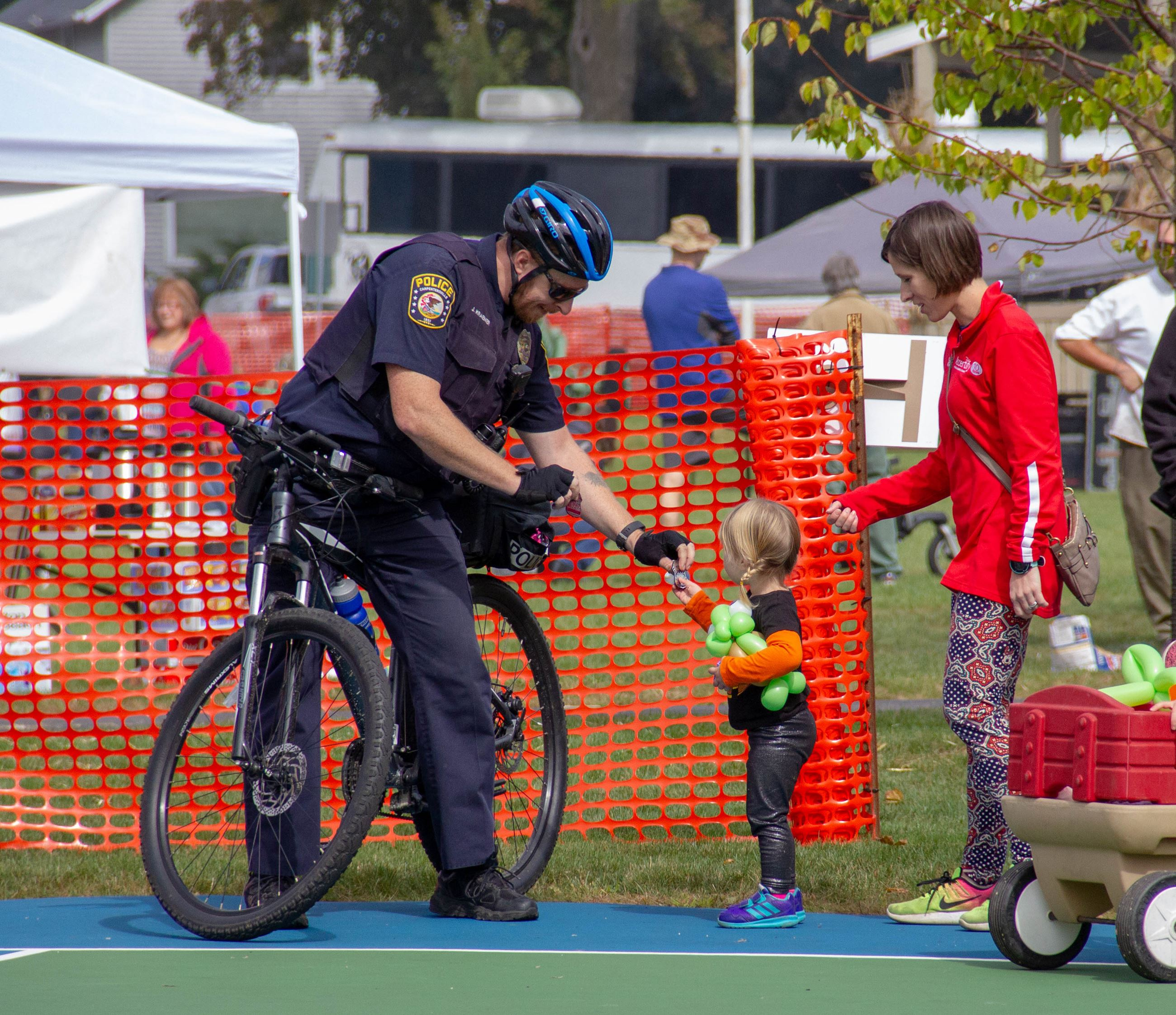 Bike Patrol Officer with Child